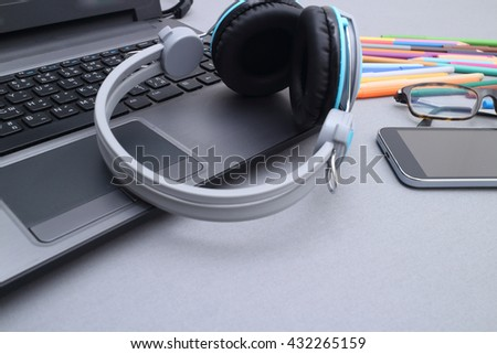 headset on laptop computer keyboard concept for communication, it support, call center and customer service help desk - stock photo
