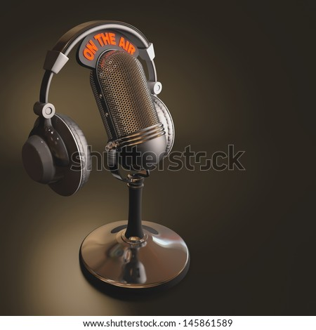 Headset on top of a classic microphone. - stock photo