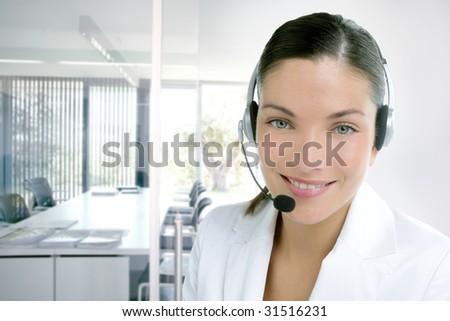 Headset phone business woman dress in white studio shot [Photo Illustration]