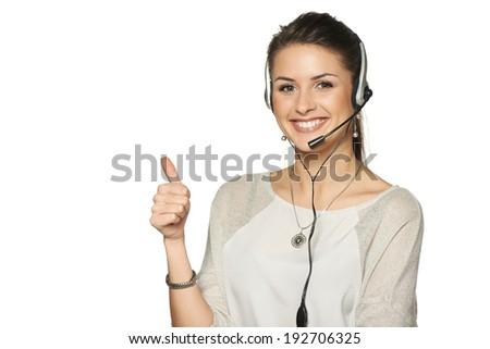 Headset woman call center operator smiling gesturing thumb up, against white background - stock photo