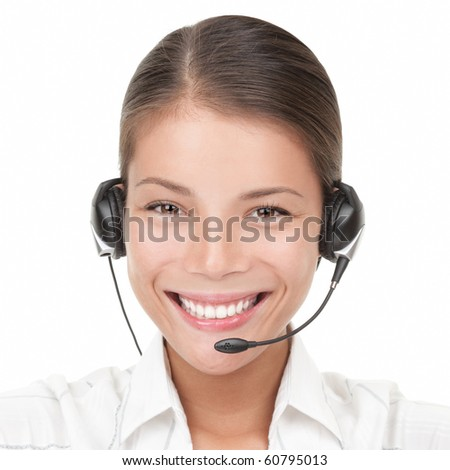 Headset woman from call center. Portrait close-up of young smiling woman from call center wearing headset. Isolated on white background. Mixed Asian / Caucasian woman - stock photo