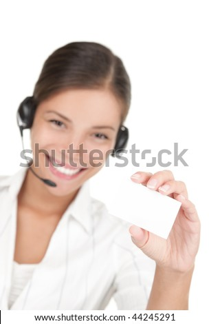 Headset woman holding business card. Beautiful young mixed race chinese / caucasian woman isolated on white background. - stock photo