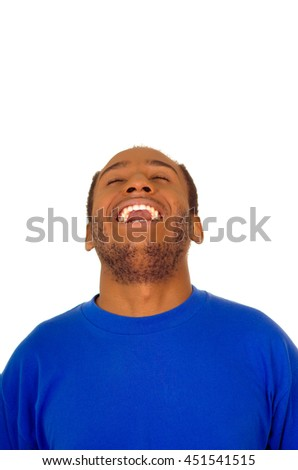 Headshot man wearing strong blue colored t-shirt laughing hard while tilting head backwards, white studio background - stock photo