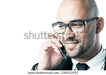 Headshot of a businessman holding a cell phone isolated on white - stock photo