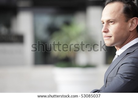 Headshot of a businessman with a blurry background