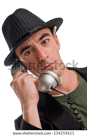Headshot of a Caucasian Male Wearing a Fedora Style Hat and Talking on the Phone - Slightly Angled