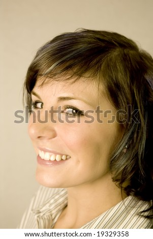 Headshot of a cute young woman on white - stock photo