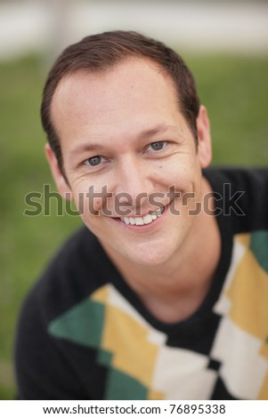 Headshot of a handsome man smiling - stock photo