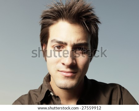 Headshot of a handsome young man - stock photo