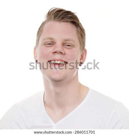 headshot of a happy young man laughing  - stock photo