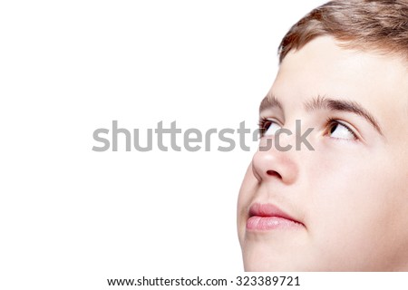 Headshot of a teen boy looking up, isolated on white background - stock photo