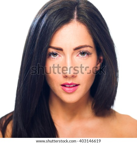 Headshot of a young, beautiful Caucacian femal. Isolated on white. Shot with a shallow depth of field. - stock photo