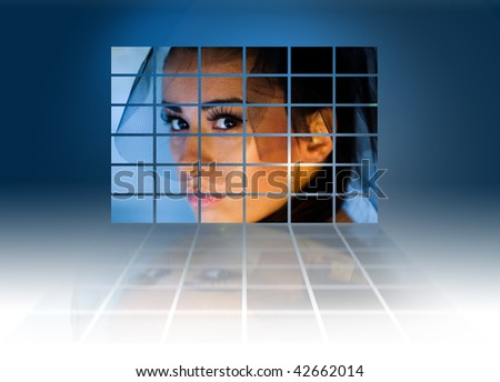 Headshot of a young sexy woman on large video wall. Television production technology concept - stock photo