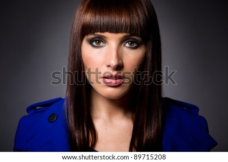 Headshot of an attractive brunette caucasian model looking directly at camera - stock photo
