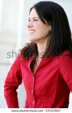 Headshot of an attractive business, corporate female in a suit. Suitable for a variety of commercial, finance and business themes. - stock photo