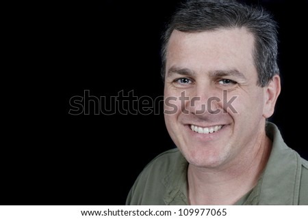 Headshot of an attractive man with blue eyes - stock photo