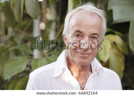Headshot of an old man - stock photo