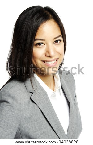 Headshot of Asian business woman smiling for camera - stock photo