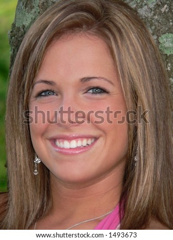 headshot of attractive teenage girl with big smile