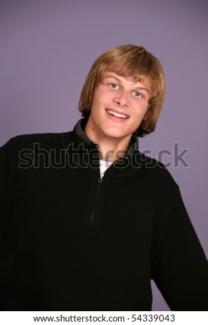 headshot of cuteteen boy with silly smile