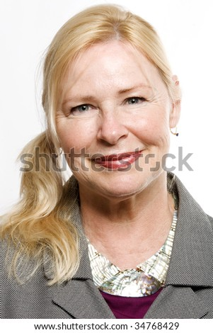 Headshot of happy older business woman looking at camera