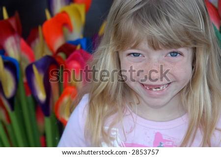 Headshot of joyful gap-tooth blonde child. - stock photo