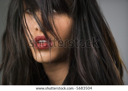Headshot of pretty young woman with long black hair.