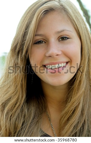 Headshot of smiling, happy, young woman