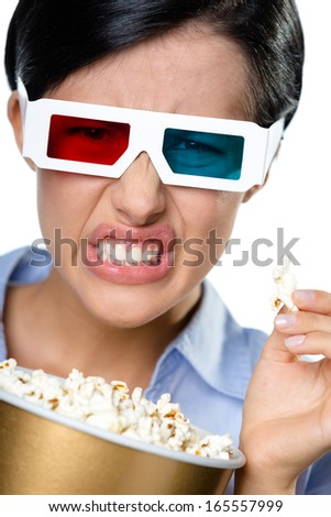 Headshot of the girl in 3D glasses eating popcorn and watching the cinema, isolated on white - stock photo