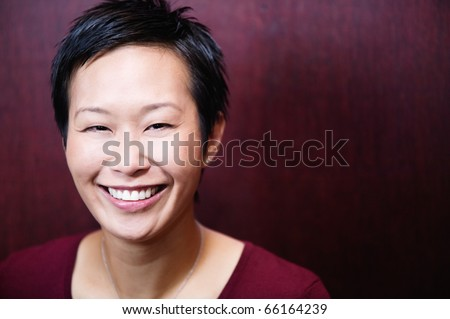 Headshot of woman smiling at camera - stock photo