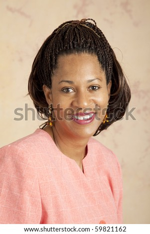 Headshot portrait of a beautiful african american businesswoman. - stock photo