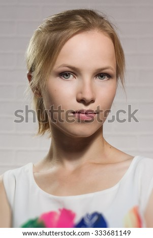 Headshot portrait of the young blonde girl - stock photo