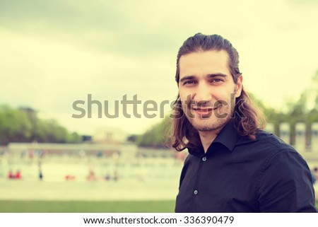 Headshot portrait of young man smiling isolated on outside outdoors Washington DC Lincoln Memorial background - stock photo