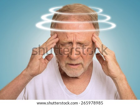 Headshot senior man with vertigo. Elderly male patient suffering from dizziness isolated on light blue background   - stock photo