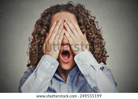 Headshot young scared woman covering eyes wide open mouth isolated on grey wall background. Human emotions face expressions feelings reaction perception gesture  - stock photo