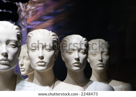 Headshots of several white mannequins - stock photo