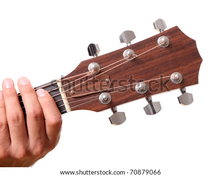 Headstock of the guitar with hands touching - stock photo