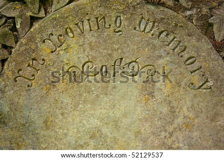"Headstone with inscription ""In Loving Memory""  Area left blank for name drop. - stock photo"