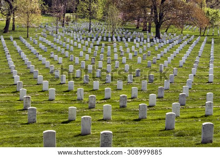 Headstones at the Arlington National Cemetery in Virginia, USA - stock photo