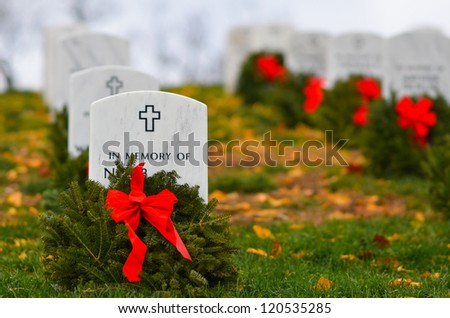 Headstones in Christmas time in Arlington National Cemetery - Washington DC United States - stock photo