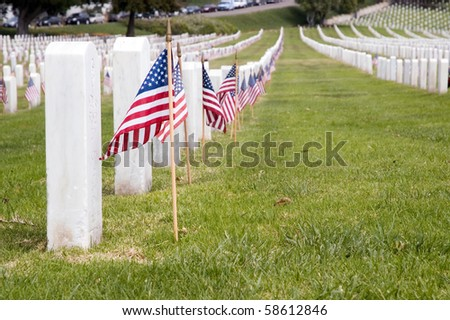 Headstones with American flags. - stock photo