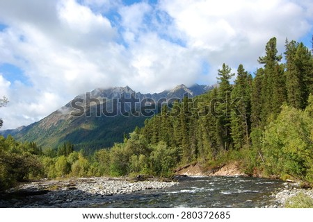 Headwaters of the mountain river and the extinct volcano. Bilin river, Sayan Mountains, Russia.