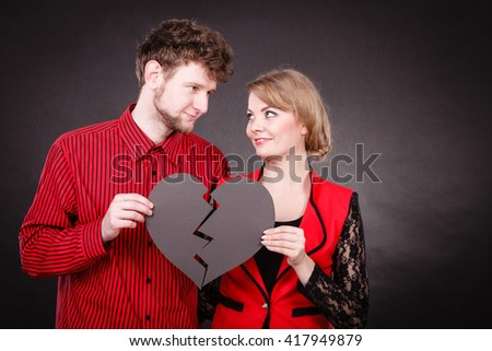 Heal love concept. Couple woman and man holding two halves of broken heart  going to be joined in one.  - stock photo