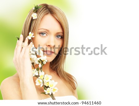 Healhy young woman with spring blossom in hands - stock photo