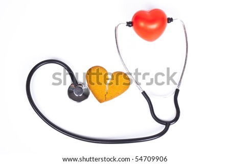 healing a broken heart with  a stethoscope on white background - stock photo