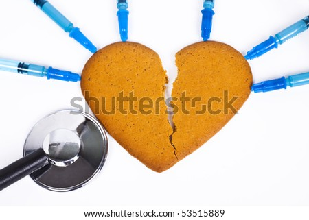 healing a broken heart with blue syringe and a stethoscope on white background - stock photo
