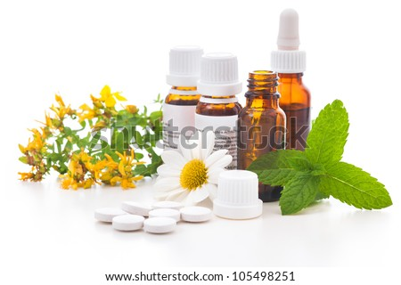 Healing herbs and medicinal bottles. Alternative medicine concept - stock photo