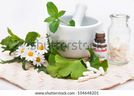 Healing herbs in mortar. Alternative medicine concept - stock photo