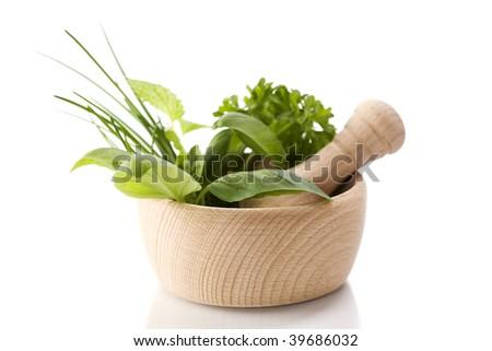 Healing herbs over white - stock photo