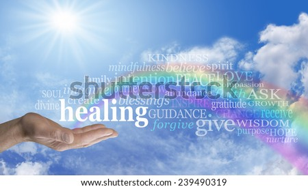 Healing Rainbow Sky Word Cloud - Blue sky and clouds with a man's hand palm up and the word 'healing' above as a rainbow arcs out of his palm with healing words floating across the rainbow  - stock photo